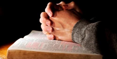 cropped-praying-hands-bible